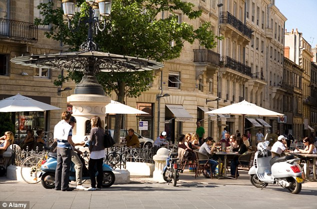 An outdoor cafe area in Bordeaux, France, which is known for its fine wines