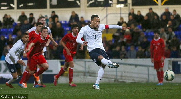 Spot on: Baker slots home the penalty in the 59th minute at Chester's Swansway Stadium as England prepared for their European Championship qualifiers in May in superb fashion