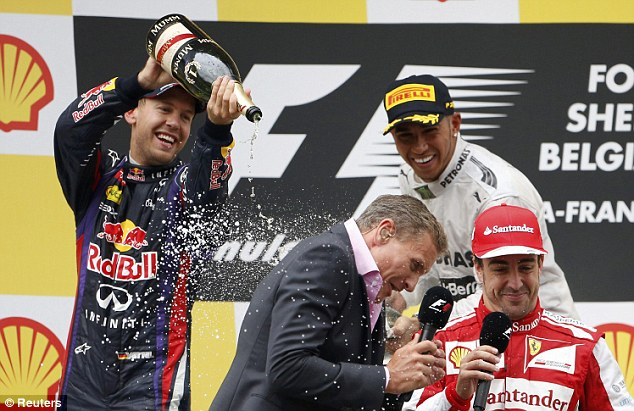 Part of the job: Coulthard is soaked by Vettel and Hamilton while on BBC duty last year