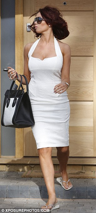 She's all white: Amy chose two different white dresses to step out in on Thursday