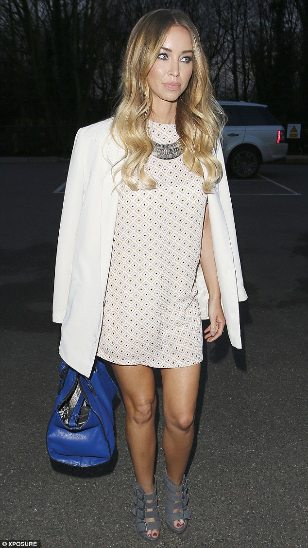 Light: Lauren Pope wore a white jacket over a spotted minidress for the night