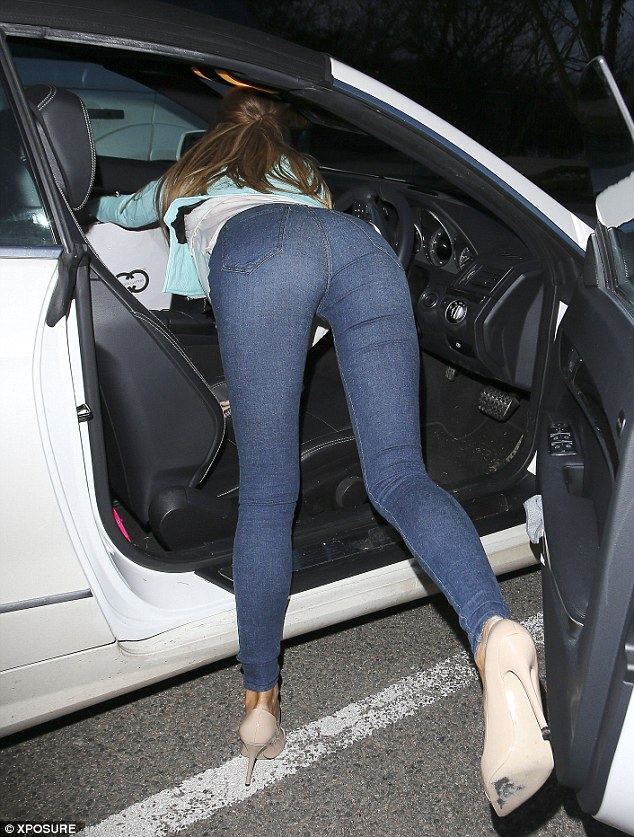 Forget something? Chloe reaches into her car to get something out of the passenger seat