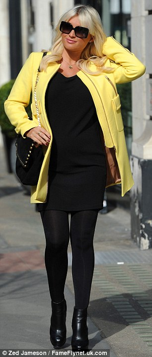 Stylish: Sam looked cute in a floral bomber jacket while Billie opted for bright colour in a yellow coat