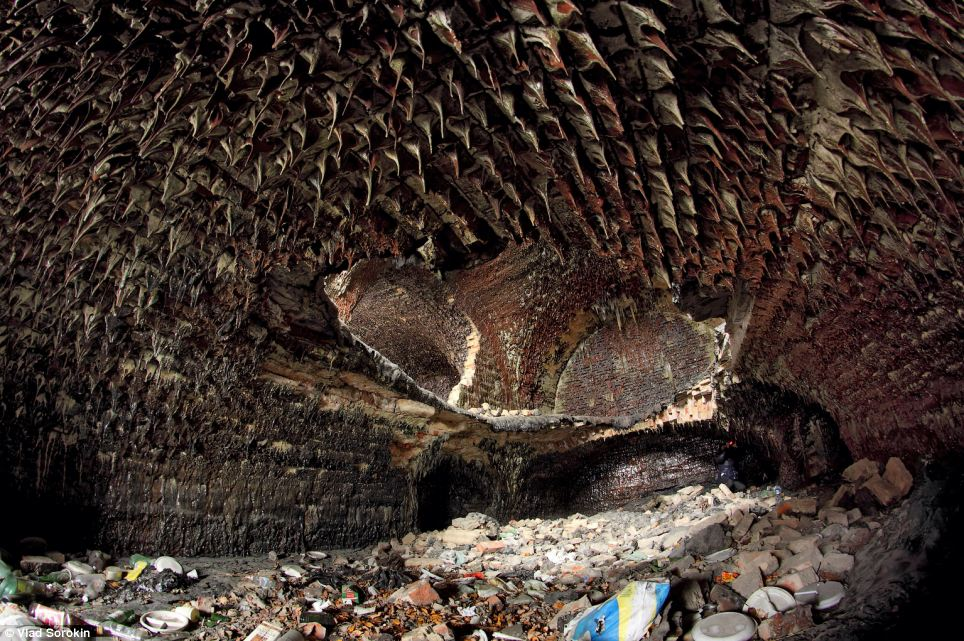 Molten: As the mercury in the depths of the basement soared, the flames melted the brick and the ceiling. As the rooms cooled the molten brick formed stalactite-like formations hanging from the roof