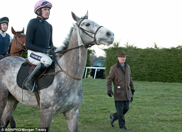 Willie Mullins (right) oversees the Arkle preparation of market leader Champagne Fever