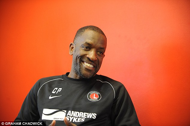 Sheepish: Charlton Athletic manager Chris Powell smiles as he recalls swinging from the crossbar