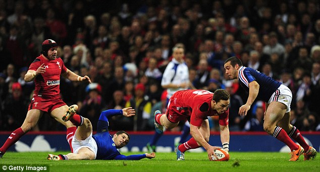 Unstoppable backs: George North scores for Wales against France at the Millennium Stadium