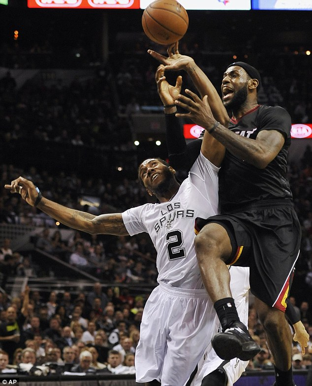 Blame game: Miami Heat forward LeBron James (right) says his poor performance against San Antonio Spurs was down to the short-sleeved jerseys