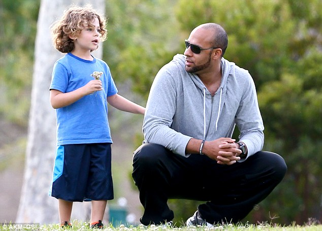Daddy daycare: Kendra's husband Hank Baskett also joined the duo on the trip to the park, and clearly enjoyed spending time with his little boy