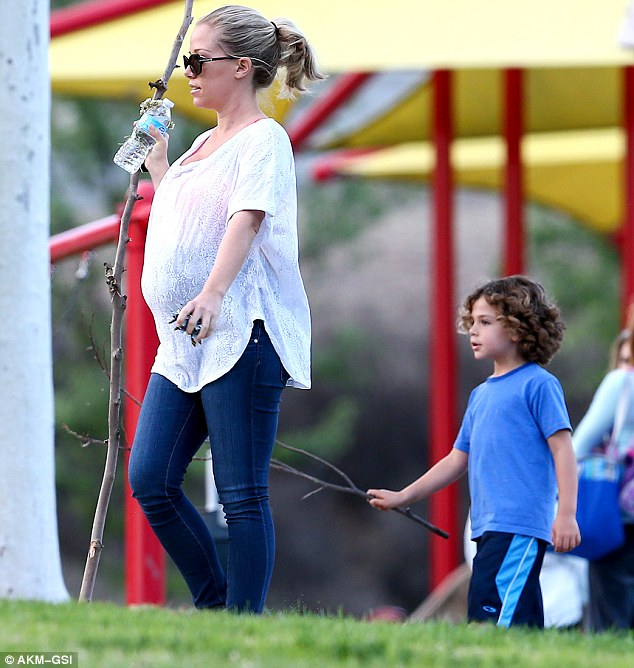 She's already got her hands full! Kendra Wilkinson showed off her growing bump as she took her son Hank to the park in Malibu on Wednesday
