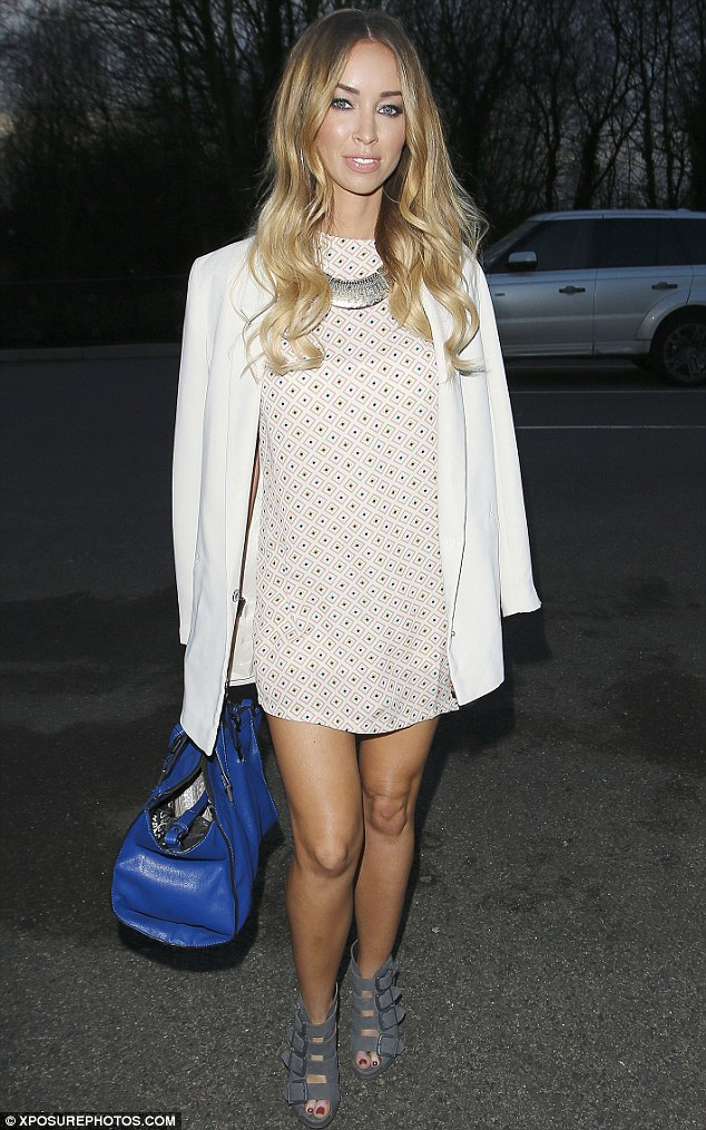 Flashing her pins: The DJ's geometric-print shift dress was taken from her new clothing range for InTheStyle.co.uk