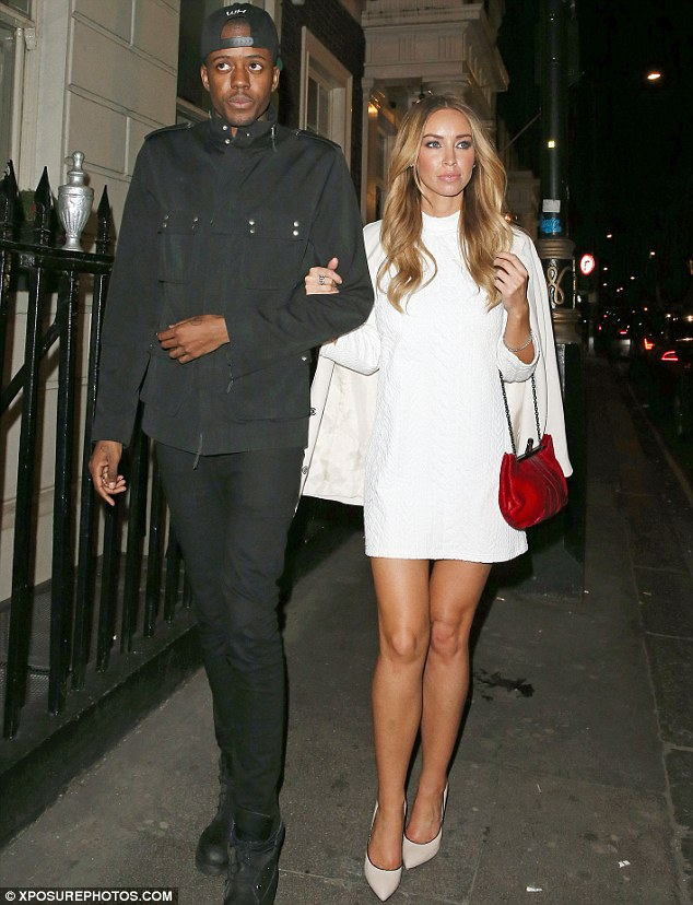 Arm-in-arm: Lauren teamed her chic minidress with a red vintage-style bag and nude heels