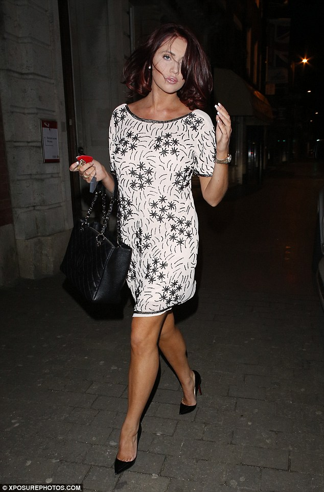 Glam girl: Amy Childs stepped out in a dress from her own collection as she headed to her brother Billy's gig at the Sugar Hut club in Essex