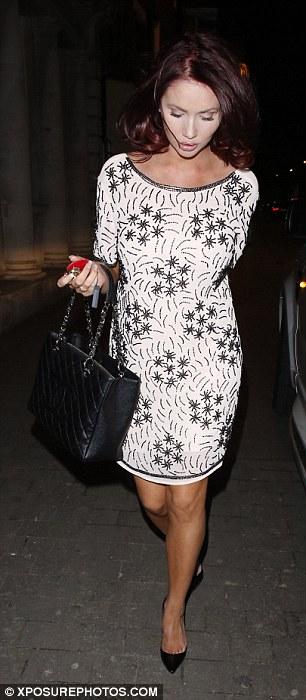 Designer diva: Amy was rocking a Chanel handbag and Christian Louboutin heels