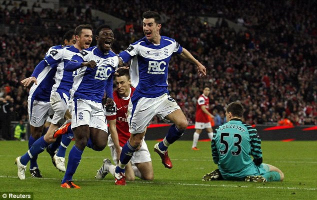 Silverware: Obafemi Martins (second left) scores Birmingham City's winning goal against Arsenal in the 2011 League Cup final