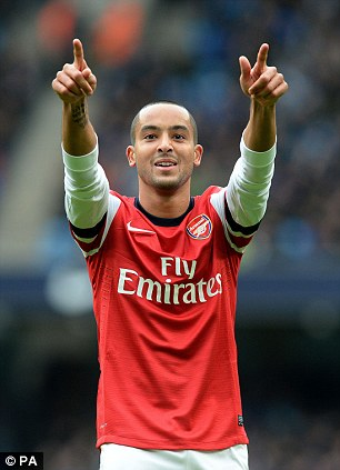 Out: Theo Walcott suffered a cruciate ligament injury which has ruled him out for the season