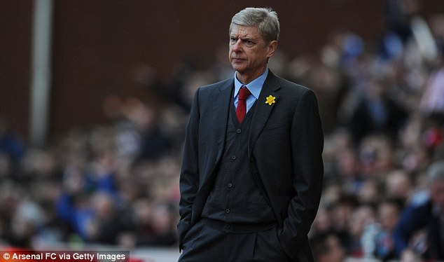 Tough time: Arsene Wenger must navigate his side through a difficult set of fixtures in March
