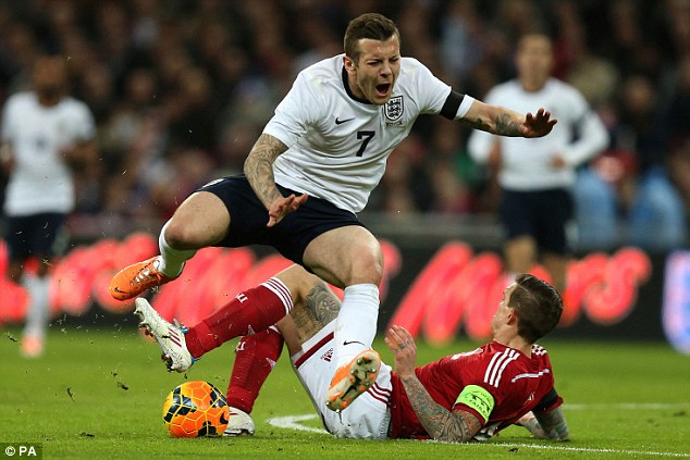 Agony: Jack Wilshere is out for six weeks after suffering a hairline fracture against Denmark