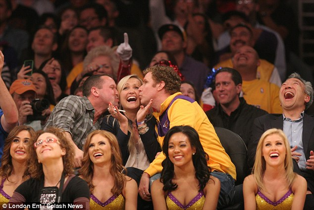 Cheeky: Will Ferrell (right) stole a kiss from a woman at the Los Angeles Lakers game on Thursday night