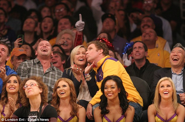 Embarrassed: Will looks up at the Jumbotron as he plants a kiss on the woman's cheek