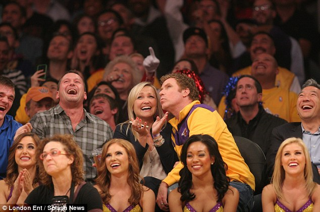 Going for it: Will's jokey smooch provided much hilarity to the rest of the Lakers crowd