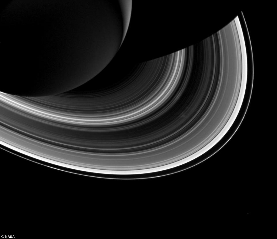 Among the interplay of Saturn's shadow and rings, Mimas, which appears in the lower-right corner of the image, orbits Saturn as a set of the ever-intriguing spokes appear in the B ring (just to the right of centre)