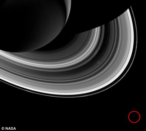 Saturn's moon Mimas, also known as the ¿Death Star¿ can be seen as a pin prick of light (circled in red)