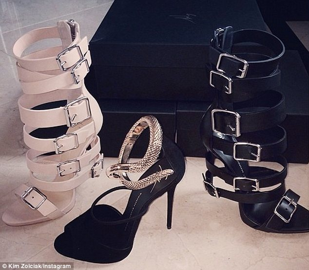 Poor taste: Kim Zolciak's husband Troy Biermann spent almost $5,000 on designer shoes for her even though they have been accused of owing thousands in unpaid taxes