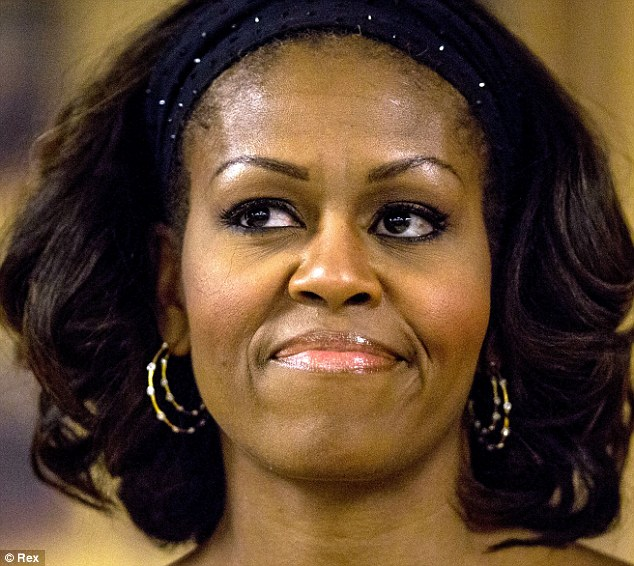 'As we age our brows naturally thin and need a very defined arch to create a lifting and anti-aging effect,' said brow expert Shavata Singh, who prefers Mrs Obama's thin brows (pictured 2013)