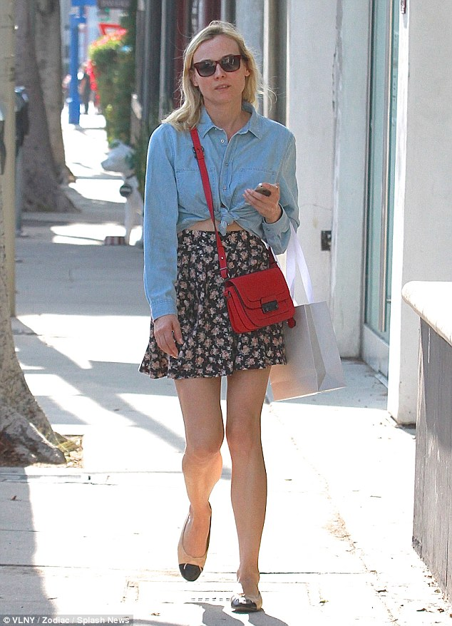 That's more like it! Diane Kruger was seen shopping in a tied up denim shirt and floral print skirt on Melrose Avenue in Los Angeles, California on Thursday