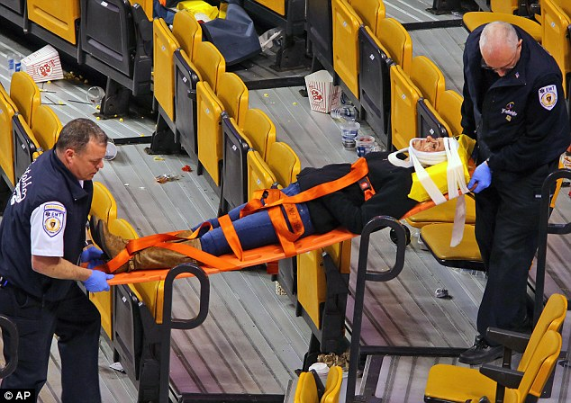 Carried away: Emergency workers remove Sabina Grasso from the arena on a stretcher for precaution - officials later said her injuries were minor