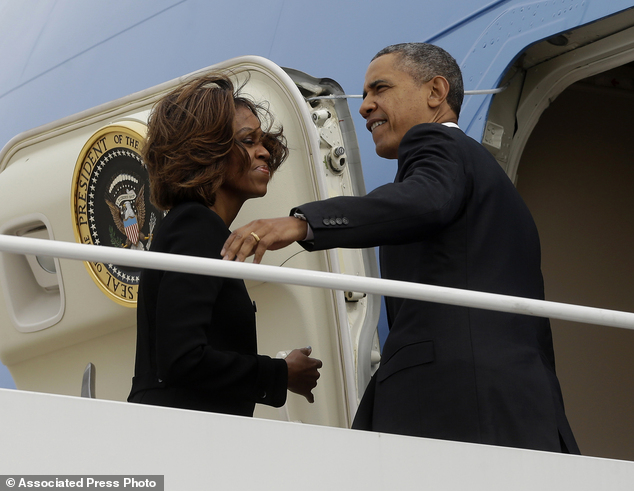 Business and pleasure: President Barack Obama and first Lady Michelle Obama prepare to board Air Force One before their departure to Florida for a weekend getaway