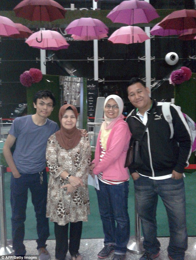 Victims: This photo released by Hamid Ramlan shows his daughter Norliakmar Hamid (second right) and her husband Razahan Zamani (right), who were passengers on a missing Malaysia Airlines flight