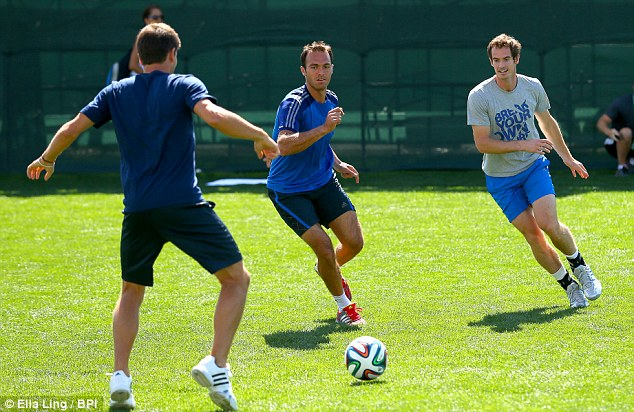 Relaxed: The day before, Murray was playing a spot of football with friend and fellow Briton Ross Hutchins