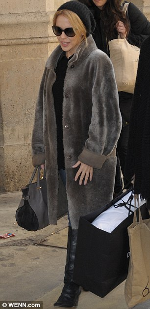 Parisian chic: Kylie Minogue arrived in Paris on Saturday in her winter coat, beanie and knee-high boots