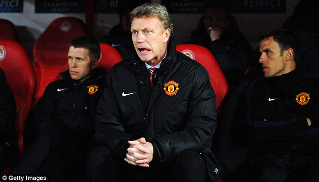 Tough act to follow: David Moyes (centre) has struggled to fill the shoes of predecessor Ferguson