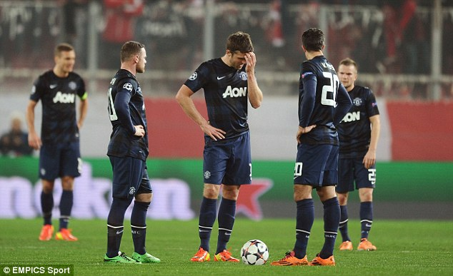 Down and almost out: United are facing Champions League exit after a 2-0 first leg defeat to Olympiacos