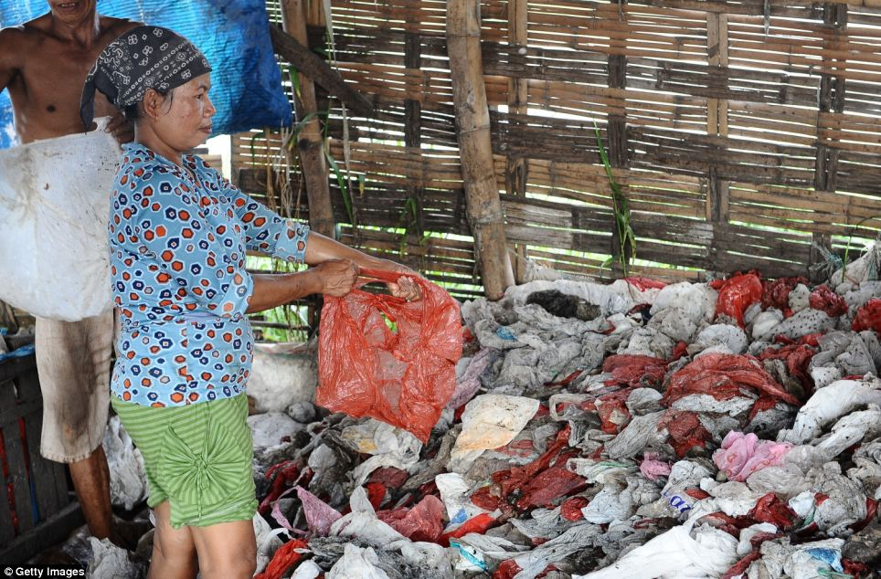 The waste picking women range from all ages and spend long hours at the landfill site sorting through the garbage and rotting waste