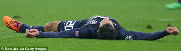 From bad to worse: Robin van Persie lies on the floor during the game against Olympiacos