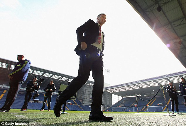 Calm before the storm: United boss Moyes walks on the pitch at The Hawthorns before the match with West Brom
