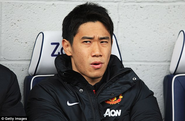 Missing out: United's Shinji Kagawa of looks on from the bench as his team take on West Brom