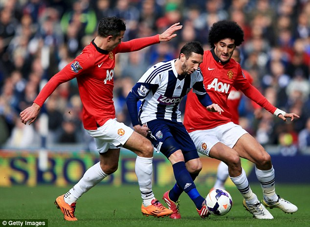 Cornered: West Brom's Morgan Amalfitano takes on United duo Robin van Persie, left, (L) and Marouane Fellaini