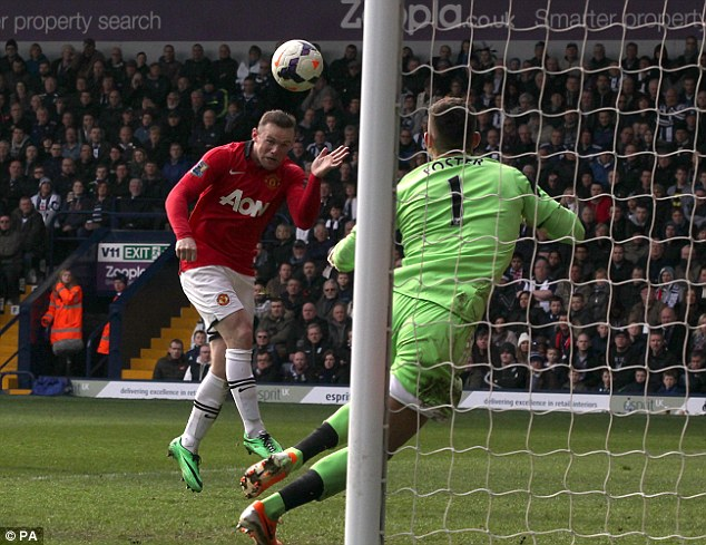 Crucial strike: Rooney heads home past West Brom keeper Ben Foster