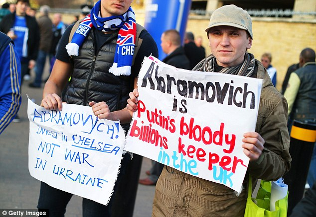 Anger: There were protests outside Stamford Bridge aimed at Chelsea owner Roman Abramovich