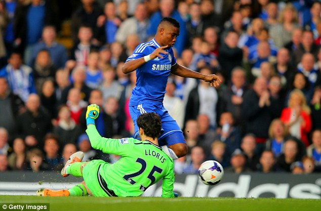 Tricky decision: Samuel Eto'o rounded keeper Lloris but when he went down no foul was given