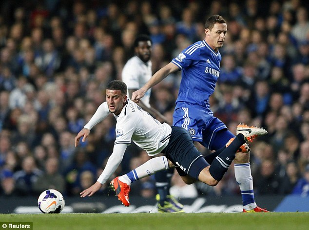 Physicality: Spurs' defender Walker feels the full force of a challenge from Nemanja Matic