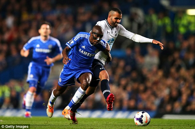 Wrestling match: The masked Ramires battles with Sandro in the middle of the park