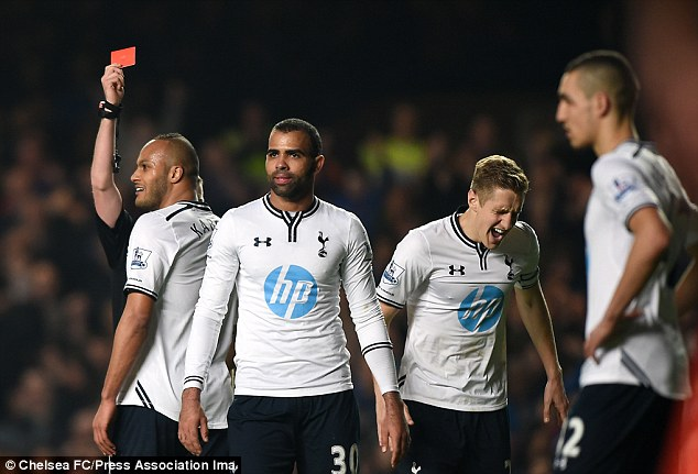Off you go: Captain Michael Dawson shows his frustration as Kaboul is sent off for bringing down E'to