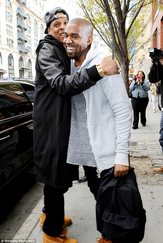 We're BFF's: Kanye West and Jay Z embrace as the rappers meet up in SoHo in April