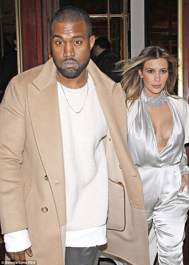 The new parents: West gazes intensely alongside his fiance while in Paris in January